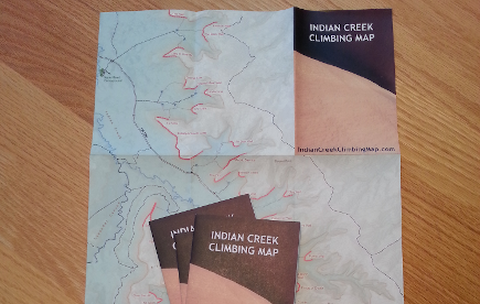 A printed and folded map showing rock climbing and recreation details